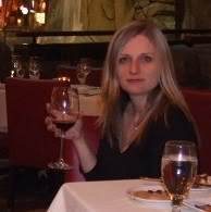 Diane Hochman holding up a glass or red wine